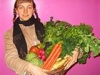 Girl-holding-basket-vegetables