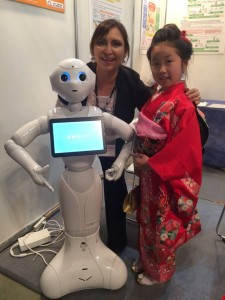 Mariella with robot and Japanese child , photo courtesy Mariella Guerra